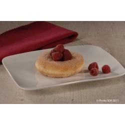 Donut au sucre accompagné de framboises
